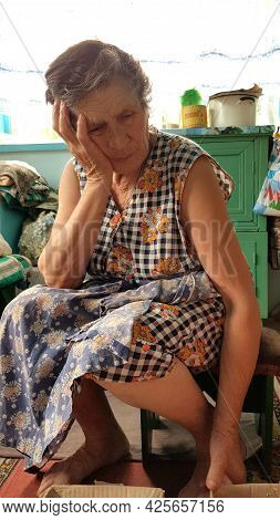 Concept Of Sorrow And Grief. Senior Woman In Upset Mood. 80s Granny Holds Hand At Her Head In Sad Em