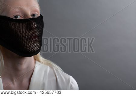 Closeup Portrait Of White Caucasian Albino Blond Woman Fashion Model Wearing Quarantine Medical Face