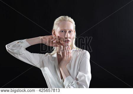 Young Blonde Albino Woman Doing Face Building Facial Gymnastics Self Massage And Rejuvenating Exerci