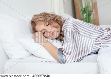 Pretty Woman Sleeping In Bed. Tired Woman Sleeping In Bed At Home.
