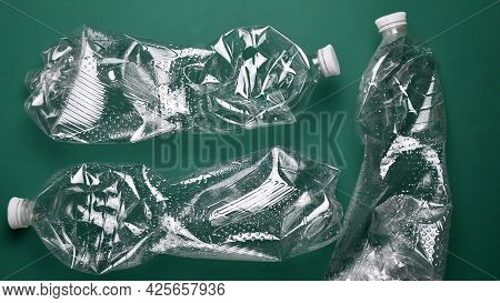 Crumpled Transparent Pop Bottles With Removed Labels Ready For Recycling. Used Plastic Bottles From
