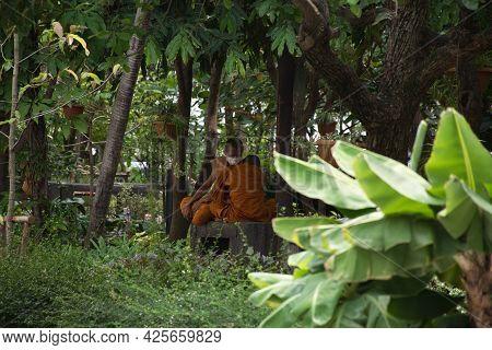 Bangkok, Thailand 04.07.2021 Monks In The Park Surrounding Wat Paknam Phasi Charoen Temple