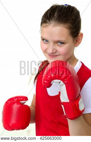 Sports Boxer Teenage Girl. Close Up Portrait Of Beautiful Girl In Red Sports Uniform And Boxing Glov