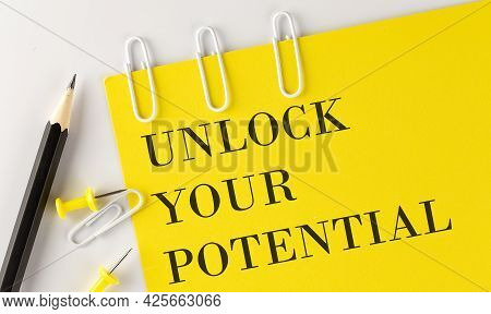 Unlock Your Potential Word On The Yellow Paper With Office Tools On The White Background