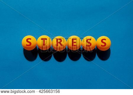 Stress And Business Symbol. The Concept Word 'stress' On Orange Table Tennis Balls On A Beautiful Bl