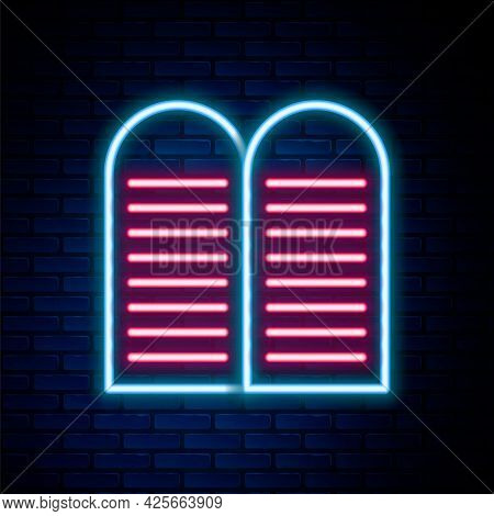Glowing Neon Line The Commandments Icon Isolated On Brick Wall Background. Gods Law Concept. Colorfu
