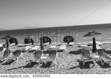 Rhodes Greece 21. September 2018 Black And White Picture Of Sun Loungers At Elli Beach In Rhodes Gre