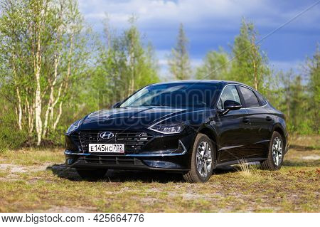 Novyy Urengoy, Russia - June 14, 2021: Black Sedan Hyundai Sonata In The Wood.