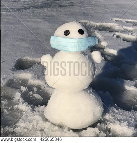 Little Snowman In A Mask On The Snow