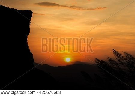 The Morning Sun And The Orange Sky Above The Mountains. Twilight Sky Background. Colorful Sunset Sky