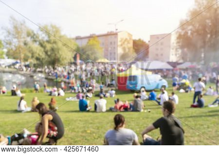 Blurred Group Of People Enjoy Outdoor Picnic And Festival Open-air Concert In Public Park