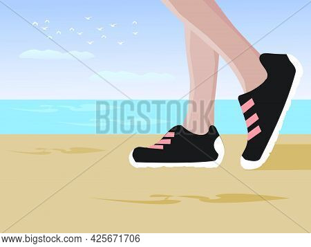 Close Up Legs Wearing Sneakers Walking On The Sandy Beach. With The Sea And Sky In The Background