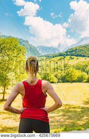 Young Woman With Sportswear For Trekking Observing Her Route Goal. Hiker In Picos De Europa.