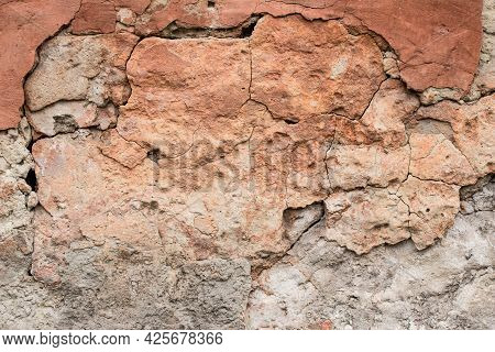 Destroyed Old Clay Wall, Abstract Brown Background. Cracked Grunge Surface, Texture. Damage Of Facad