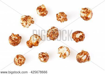 Heap Of Delicious Popcorn Covered With Milk Chocolate Isolated On White Background. Scattered Popcor