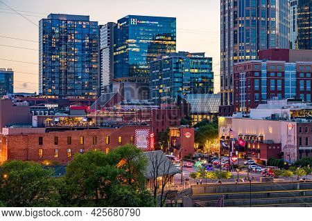 Nashville, Tennessee - 27 June 2021: Nashville Skyline With Focus On The Broadway Street In The Even
