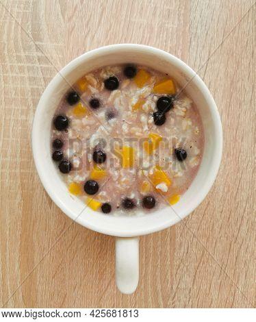 Porridge (oatmeal) With Orange Pumpkin And Blueberries