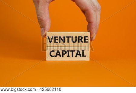 Venture Capital Symbol. Wooden Blocks With Words Venture Capital On Beautiful Orange Background, Cop