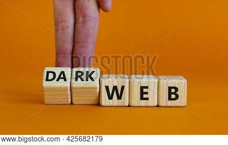 Dark Web Symbol. Businessman Turns Wooden Cubes And Changes The Word Web To Dark Web. Beautiful Oran