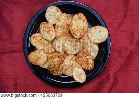 Tasty And Crispy Thick Sundried Potato Chips Wafers. Red Chilly Sprinkled Spicy Sun Dried Without Fr