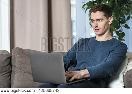 Portrait Of Amazed Surprised Shocked Guy, Young Man Using Laptop, Typing On Computer With Excited Fa
