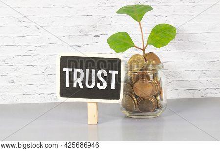 Trust Word Written On Wood Block. Trust Text On Table, Concept