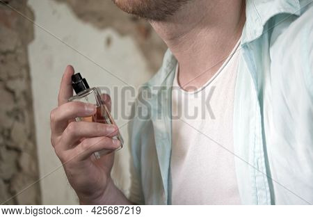 Men Perfume In The Hands Of A Man.