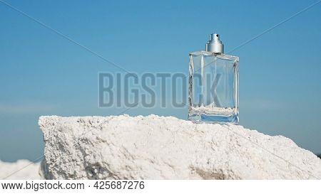 Men's Perfume On A Snow-white Salt Mountain. For Men, Perfume Copy Space.