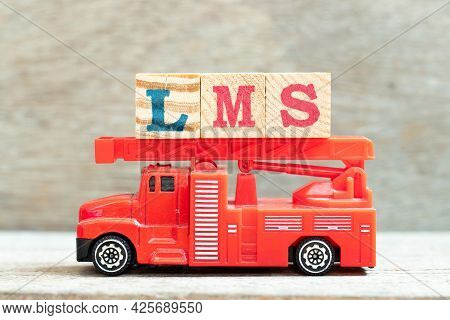 Fire Ladder Truck Hold Letter Block In Word Lms (abbreviation Of Learning Management System) On Wood