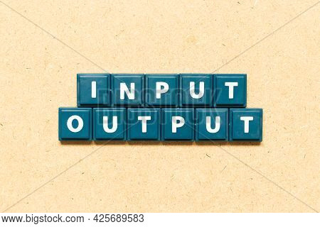 Tile Alphabet Letter In Word Input Output On Wood Background