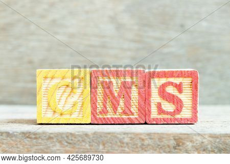 Color Alphabet Letter Block In Word Cms (abbreviation Of Content Management System) On Wood Backgrou
