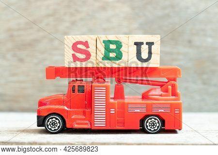 Fire Ladder Truck Hold Letter Block In Word Sbu (abbreviation Of Strategic Business Unit) On Wood Ba