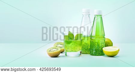 Fresh Green Smoothie With Fruits On Light Green Background.  Copy Space Banner.