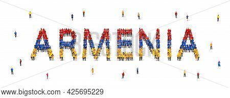 A Crowd Of People Stands In Blue, Yellow And Red Robes, Making Up The Word Armenia. Flag Of Armenia