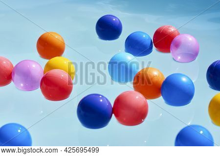 Summer Vacation Concept With Colorful Ball In Swimming Pool Water, Close-up