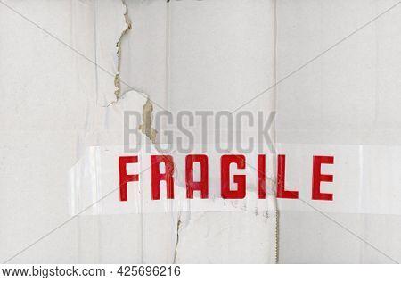 Fragile Label On A Cardboard Packet Box
