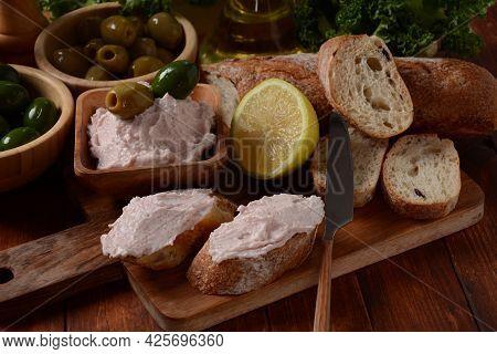 Taramosalata Greek Spread Paste (pate) Made Of Ground Fish, Shrimps, And Caviar, Served With Lemon.