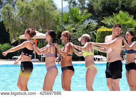 Marmaris, Turkey - July 2021: Happy People Doing Aqua Aerobics In A Swimming Pool. Water Sport, Vaca