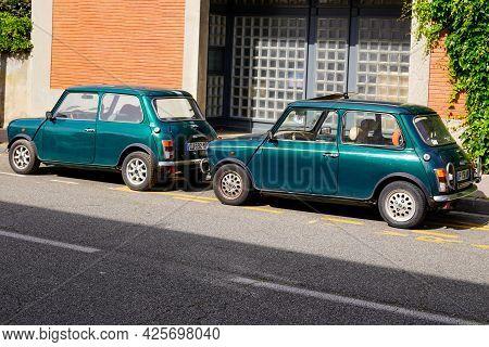 Sète , Ocitanie France  - 06 30 2021 : Mini Cooper Old Timer Classic Two Cars Limited Edition In Bri