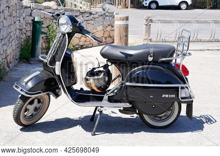 Sète , Ocitanie France  - 06 30 2021 : Vespa Px 125 Scooter With Vintage Look In City Street Parked