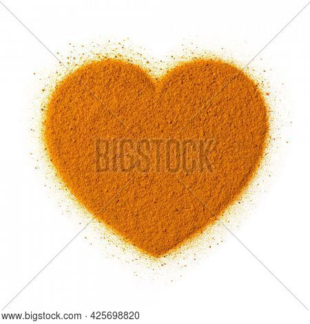 Yellow Turmeric powder in heart shape isolated on white background