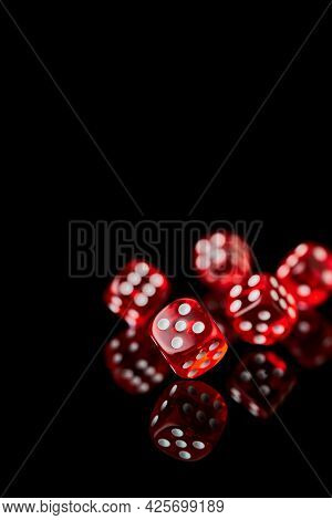 Red And White Craps Or Dices On Reflective Black Background