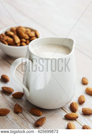 Jar With Almond Milk And Almonds On The Table