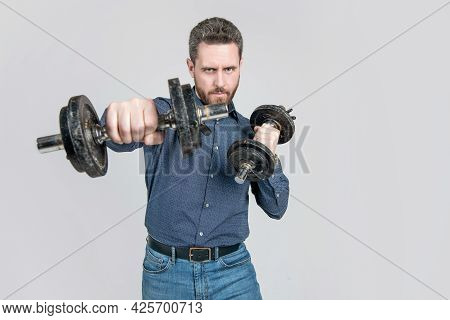 Successful Strong Mature Businessman With Beard Training Punching With Barbells, Copy Space, Power.