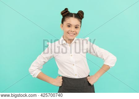Happy Teenage Girl Back To School Standing With Arms Akimbo Blue Background, Teenager