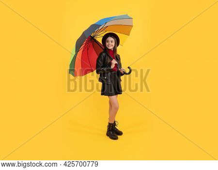 Happy Stylish Girl In Leather Wear. Cheerful Teen Child Hold Colorful Parasol. Kid In Hat