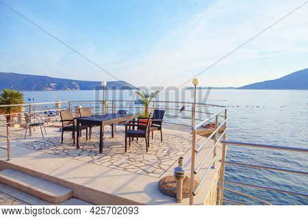 Restaurant Terrace On The Coast . Perfect Place For Romantic Dinner . Seaside Terrace With No People