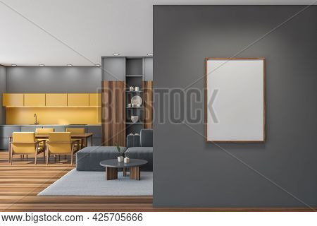 Empty Placard On Grey Wall With Yellow Studio Kitchen Interior. Living Room Area, Table, Armchairs,
