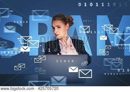 Businesswoman Wearing Suit Is Sitting At Workplace Looking At Laptop Screen And Showing Stop Gesture