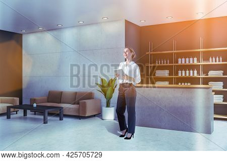 Smiling Attractive Woman Holding Tablet Device And Waiting For Clients In Reception Area Of Modern L